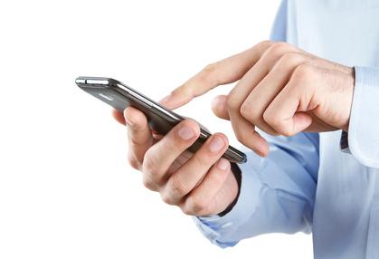 Close up of man using smart phone isolated on white background